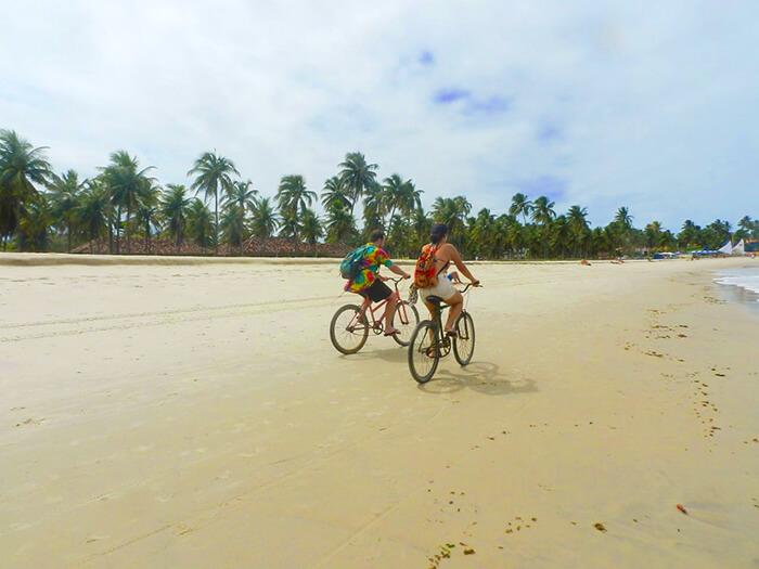 Cycling down the beach