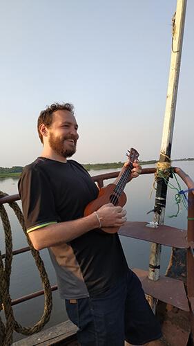 Playing ukulele on the boat