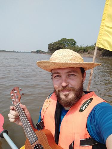 Ukulele playing on a kayak